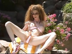 Redhead milf blasting outdoors for fun Thumb