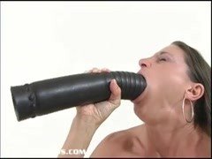 Petite brunette stretching her pussy with a thick dildo Thumb