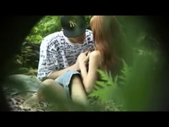 Redhead girl sucks guy dick in the woods, and then fucks him Thumb