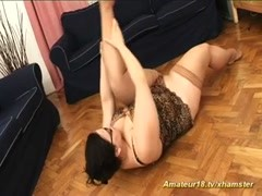 Fat contortionist stretching hard Thumb