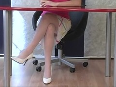 Cute secretary flashes pussy while sitting in chair Thumb