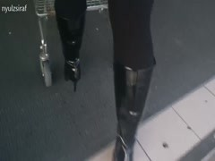 Wife went shopping in fashionable high heels knee high boots Thumb
