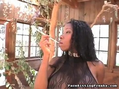Black-haired ebony Dominatrix demonstrate her curves Thumb