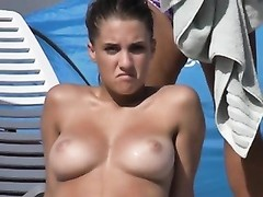 woman putting sunscreen on her orbs  one Thumb