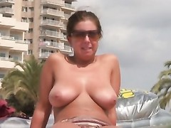 female putting sunscreen on her boobs four Thumb