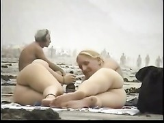 couple play on the nude beach Thumb