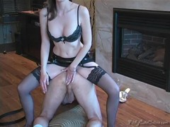 Busty slender dominatrix is spanking her slave and nailing his anus Thumb