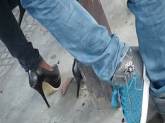 The lady play her shoes when waiting for bus Thumb