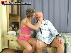 lovely teenage  girl shaving this grandpa Thumb