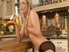 ass-fuck  in the kitchen with a attractive blonde Thumb