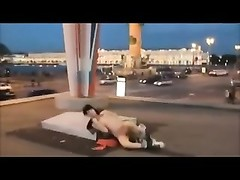 Brunette flash and masturbate on a large traffic roundabout Thumb