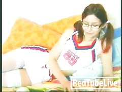 Cheerleader dame plays with her honeypot Thumb