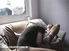 German lovers having hook-up on couch Thumb
