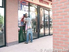 attractive teen doll  having hook-up  in public by a store window Thumb