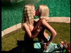 Two pretty blonde lesbian teens with big tits love to experiment by the pool Thumb