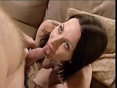 dudes pokes  his brunette girlfriend on leather sofa Thumb