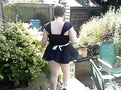 trampy maid in the garden Thumb