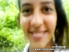 young molten Indian College lady outdoor gargling  and poking  in public garden - indiansexygfscom. Thumb