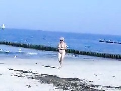 lovely steamy old lady downright  bare at beach. Public nudity Thumb