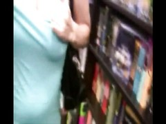two  tramps flashing and taunting  in book store Thumb
