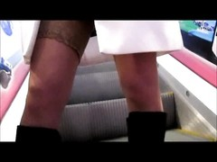 damsel flashing stockings in metro Thumb