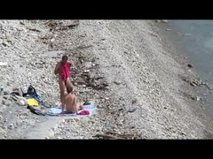 Couple fucked on a public beach while as people walked near Thumb