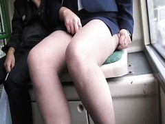 dame checking her fishnet stockings in a bus Thumb