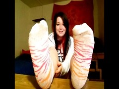 withdrawn female wants you to smell her feet. Thumb
