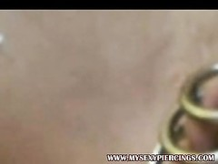 Pierced Dutch hooker with snatch piercing rings playing Thumb