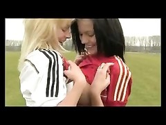 Lesbians teenagers  in football uniform long socks Thumb