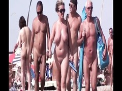 French naturist  beach Cap d'Agde people walking nude three Thumb