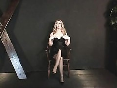 little boobies hotty in a black dress  and nylons getting ready for some act Thumb
