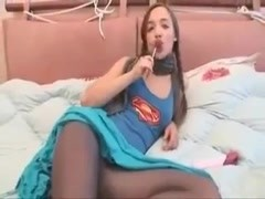Pigtailed teen wears cute tights and sucks a lollipop Thumb