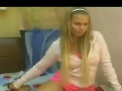 Blonde stripping from pink to show tits Thumb