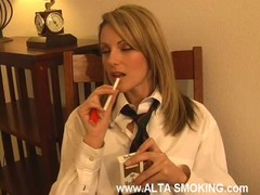 Cute blonde is slowly smoking in the awesome fetish video Thumb