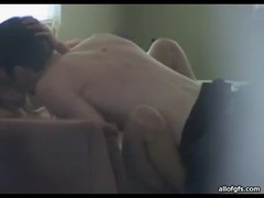 Horny teen couple enjoy some steamy foreplay on the couch Thumb