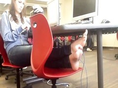 impersonal teen Feet soles in College Computer Lab Thumb