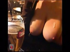 big boobed dame flashes in a public pub two Thumb