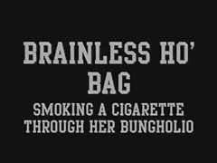 Brainless Ho' accumulate smoking a Cigarette through her Bungholio Thumb