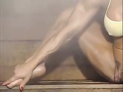 A chick bodybuilder displaying her big clittie in the sauna. Thumb