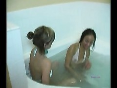 2 naughty ladies take a tub and give each other orgasams Thumb