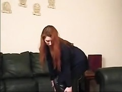 Redhead In Living Room displaying Off shoes Thumb