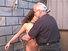 Cute brunette loves being restrained by older master for pussy torturing Thumb
