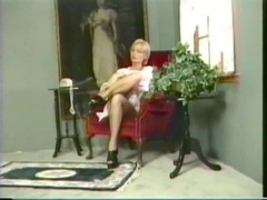 Blonde with awesome breasts fingers herself on the chair Thumb