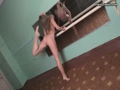 Ballerina bends her body in front of the mirror Thumb