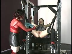 Bound busty brunette sex slave is pierced with an anal plug in dungeon Thumb
