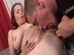 A hairy muffed redhead is ate out, then sucks Thumb