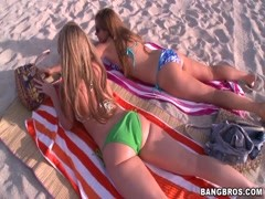 Hot gals hang out on the beach Thumb
