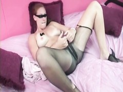 buxom redhead rips up her pantyhose Thumb