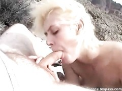 amateur blonde babe deepthroating dick on the beach Thumb